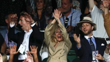 Celeb support: British-American actress Sienna Miller cheers on Federer.