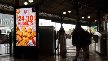An advert for KFC at Flinders Street Station.