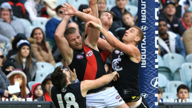 Strung out: Essendon's Jake Stringer gets swamped by Carlton defenders in the goalsquare during a marking attempt.