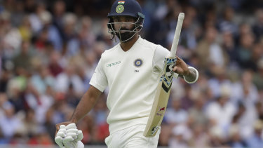 Rolled: India's Lokesh Rahul leaves the pitch after being caught.