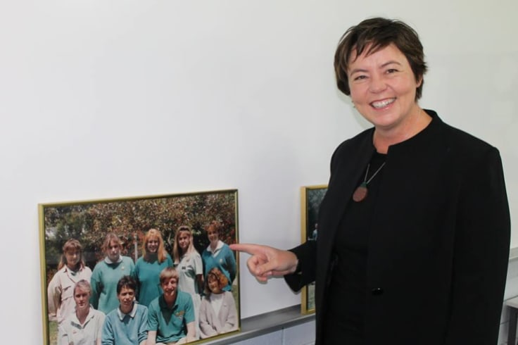 Ms King at Safety Bay High School with a photo of herself attending the school.