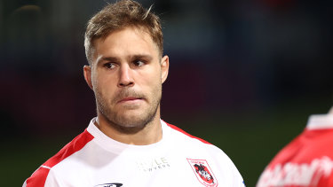Jack de Belin and 12 of his Dragons teammates have been fined by the NRL for a house party at Paul Vaughan's house.