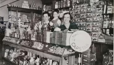 The lolly counter at the Paragon Café, Dalby, 1936. Milton Samios is behind the counter.