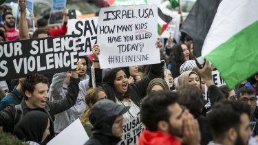 Hundreds march through the streets of downtown Chicago on Tuesday to protest the violence in Gaza.