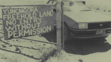 September 1980: A sign at the gate of the Noonkanbah station after WA premier Charles Court visited a drilling site on Yungngora country.