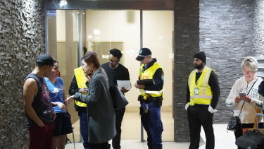 Residents evacuating Mascot Tower last Friday after receiving a letter from the building manager saying they had until 9pm to leave the complex.