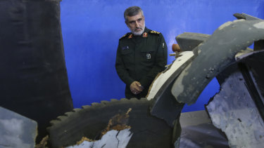 Head of the Revolutionary Guard's aerospace division General Amir Ali Hajizadeh looks at debris from what the division describes as the US drone which was shot down in Tehran in 2019.