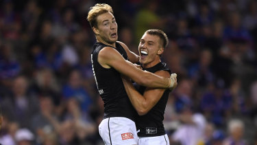 Bolt from the Blues: Harry McKay and Patrick Cripps (right) celebrate after a goal from the up-and-coming Carlton forward.