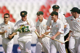 Steve Waugh and the Australian players walk off the field after defeating Pakistan at Rawalpindi stadium in 1998.