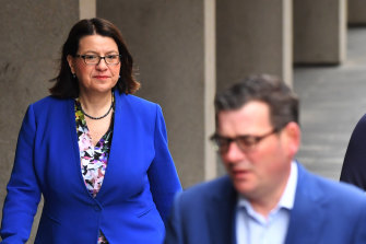 Victorian Health Minister Jenny Mikakos and Premier Daniel Andrews on their way to a COVID-19 press conference on Friday.
