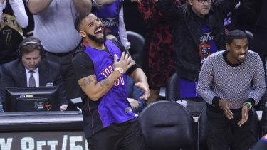 Huge Toronto Raptors fan Drake reacts courtside.