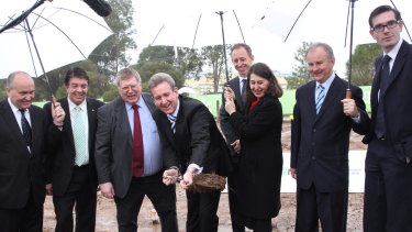 In 2013, then premier Barry O'Farrell and Gladys Berejiklian turn a sod to mark the signing of contracts for the metro line.