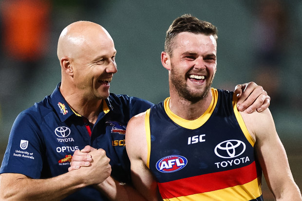 Crows midfielder Brad Crouch (right)