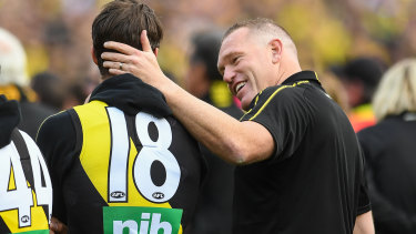 Alex Rance is consoled by assistant coach Justin Leppitsch at the grand final presentation ceremony.