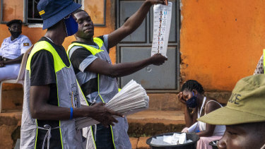 Election officials count the ballots after polls closed in Kampala, Uganda.