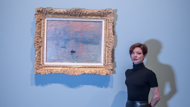 Marianne Mathieu of the Musée Marmottan Monet in Paris and curator for the NGA's Monet exhibition with Monet's Impression, Sunrise, on loan to a gallery outside of its Paris home for the first time.