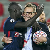 Awer Mabil celebrates with FC Midtjylland director Claus Steinlein after clinching UEFA Champions League qualification last month