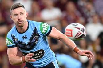 Damien Cook offloads at Suncorp.