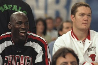 Michael Jordan and Luc Longley watch the action from the Chicago bench during match between the Bulls and Olympiakos in Paris in 1997.