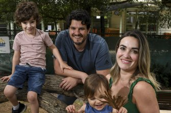 Steve Manos and Christina Paleologos, with their kids Ares, 5, and Atlas, 1, at the Brookville Kindergarten in Toorak.