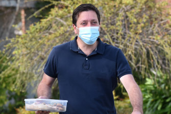 Matthew Guy delivers biscuits to the media on Monday morning.