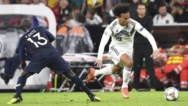 Stalemate: Germany's Leroy Sane (right) and France's N'Golo Kante challenge for the ball during their UEFA Nations League clash.