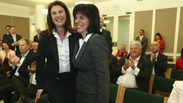 Senator Jane Hume and Liberal MP Julia Banks welcomed by colleagues after the 2016 election.