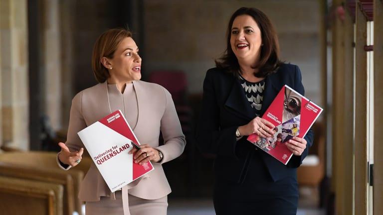 Treasurer Jackie Trad and Queensland Premier Annastacia Palaszczuk arrive for the budget media lockup.