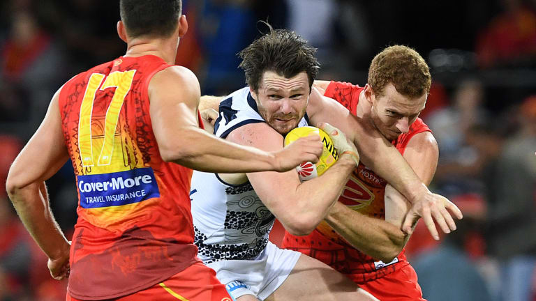 Cats star Patrick Dangerfield come under some heavy pressure against the Suns.