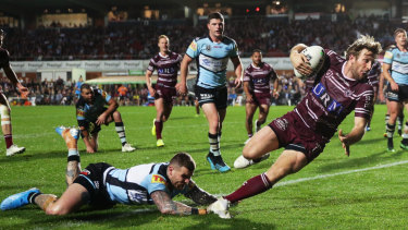 Last gasp: Brendan Elliot adds insult to injury for the Sharks.