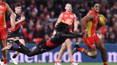 Bomber Anthony McDonald-Tipungwuti tackles Sun Aaron Hall late last season.