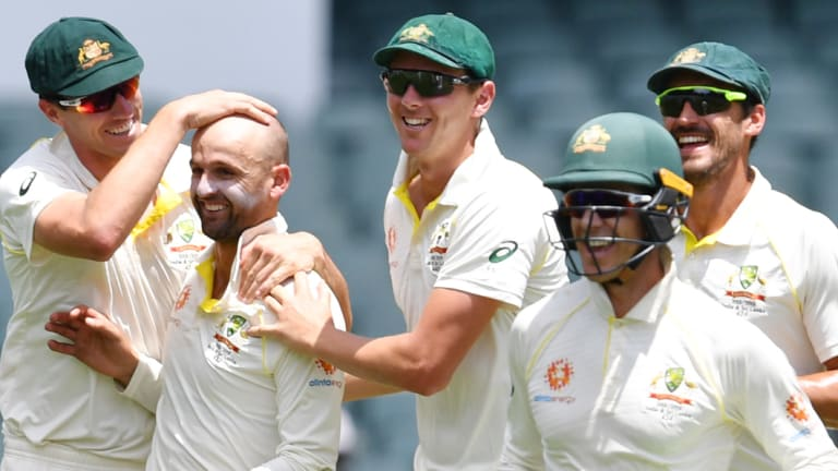 Another one bites the dust: Australian players celebrate the dismissal of Rohit Sharma.