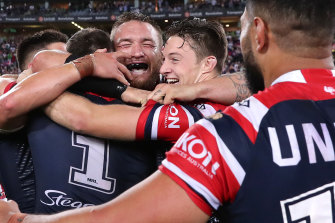 The Roosters celebrate back-to-back grand final wins after a controversial defeat of the Raiders.
