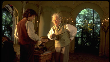 Elijah Wood as Frodo Baggins and Ian Holm as Bilbo Baggins in a still from Lord of the Rings.