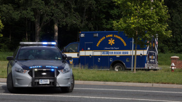 An ambulance turns on Nimmo Parkway following a shooting at the Virginia Beach Municipal Centre on Friday.