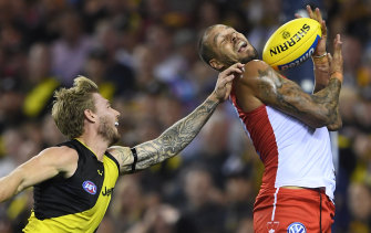 Shining light: Sydney's Lance Franklin marks in front of Nathan Broad.