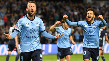 Spot on: Sydney's Adam Le Fondre celebrates his penalty goal.