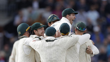 Tim Paine celebrates after Josh Hazlewood claims the final wicket of The Ashes.