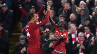 Sadio Mane (right) celebrates Liverpool's third goal on an emphatic night for the Reds.