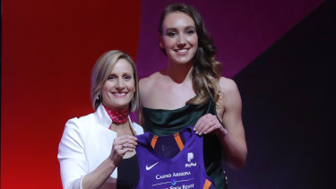 Australian Alanna Smith (right) after being taken at No.8 in the WNBA draft.