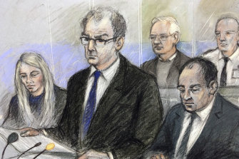 A sketch of Julian Assange, back and second from right, in court on Monday.