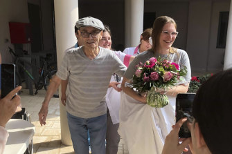 Resident Mr Chatal smiles during a fake wedding with a nurse at the care home in Lyon.