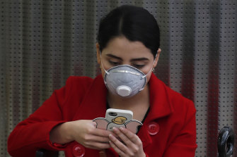 A woman wears a protective mask as a precaution against the spread of the new coronavirus at the airport in Mexico City on Friday.