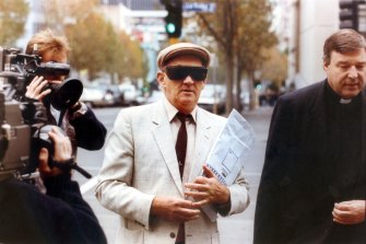 Gerald Ridsdale outside court in 1993, accompanied by George Pell.