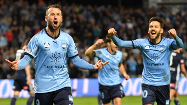 Spot on: Sydney's Adam Le Fondre celebrates his penalty goal to help the Sky Blues reach the grand final.
