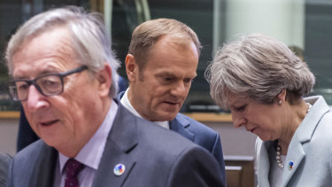 British Prime Minister Theresa May, right, speaks with European Council President Donald Tusk, second left, as European Commission President Jean-Claude Juncker looks on during a 2017 meeting in Brussels.