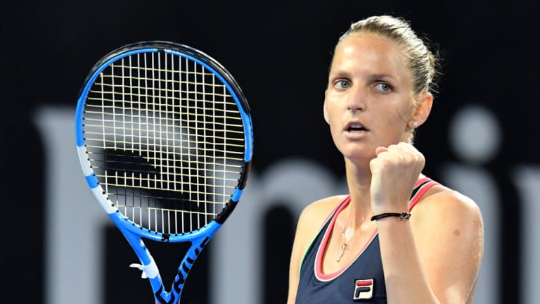 Karolina Pliskova of the Czech Republic is seen celebrating against Lesia Tsurenko of Ukraine during the final of the Brisbane International tennis tournament.