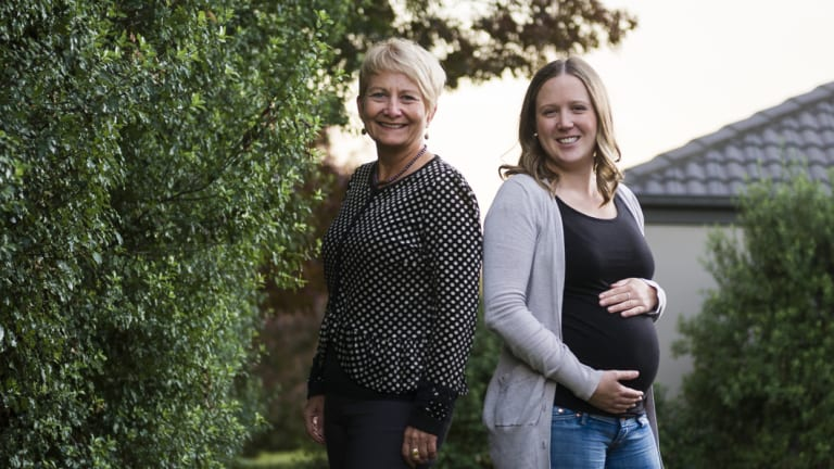 Professor of midwifery at the University of Canberra and ACT Health Deborah Davis who led the research, and expectant mother and midwife Sam Lawry (right)