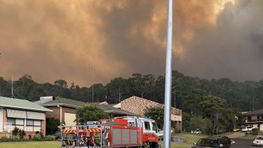 Bush fires are threatening properties in Tathra.