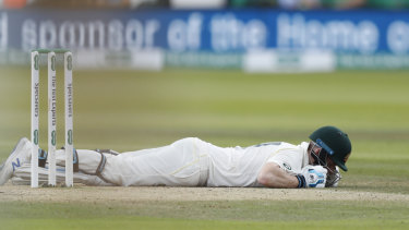 Steve Smith lies on the ground after being hit on the head by a ball bowled by England's Jofra Archer.